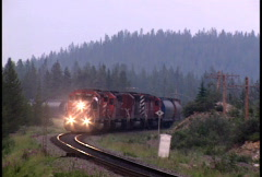 Freight Train coming round the bend - stock footage