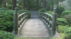 Curved Wooden Bridge in Japanese garden Stock Footage