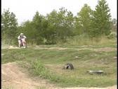 Motocross rider racing past Stock Footage