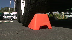 Chock Block Preventing Trailer Wheel from Rolling in RV Park Stock Footage