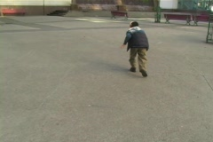 Child being chased in downtown area Stock Footage
