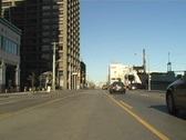Downtown traffic view from middle of street Stock Footage