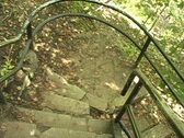 Walking down outdoor stairs to wilderness Stock Footage