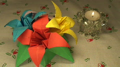 Paper tulips and candle on Christmas tablecloth, close-up Stock Footage