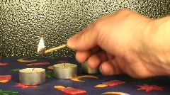 Switching candle lights on, close-up Stock Footage