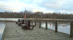 Wooden wharf and benches on lake Stock Footage