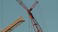 Stock Video Footage of Arrows of two cranes on blue sky background, view
