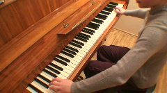 Teenage girl playing gamut on piano, scale-down - stock footage