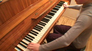 Stock Video Footage of Teenage girl playing gamut on piano, scale-down
