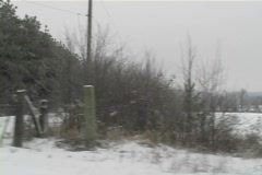 Stock Video Footage of Side window view of woods and farm land during drive