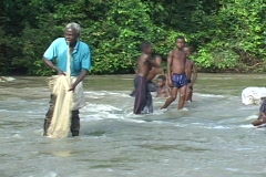 Togo, Africa: Man fishes in river with net Stock Footage