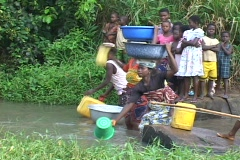 Togo, Africa: Women Collect water from river Stock Footage