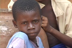 Togo, Africa: Face of young boy Stock Footage