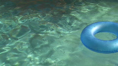Stock Video Footage of Inner Tube Floating in a Swimming Pool