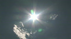 Sun Shining in a Sunburst Pattern While Zooming In Stock Footage