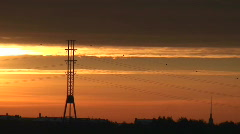 Electric power lines at sunrise Stock Footage