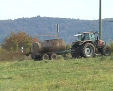 Tractor dispensing dung Stock Footage