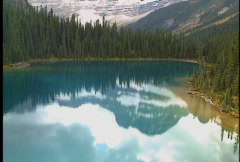 Aerial of Lake with Mountain Reflection Stock Footage