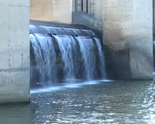 Water pouring over flood gate - stock footage