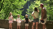 Family Looking at a Waterfall in Oregon Along the Columbia River Gorge Stock Footage