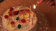 Firing candles on cake one - stock footage
