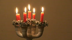 Five candles in ceramic candle holder, close-up Stock Footage