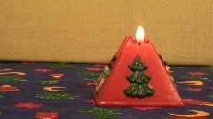 Red pyramid Christmas candle Stock Footage
