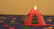Stock Video Footage of Red pyramid Christmas candle