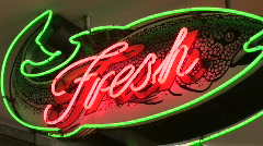 Neon Fresh Fish Sign in Pike Street Market in Seattle, Washington Stock Footage