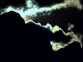 Stock Video Footage of Dark clouds passing over mountain ridge