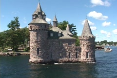Pan shot of historic castle on river Stock Footage