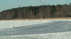 Skater on lenghty skating-rink on frozen sea Stock Footage