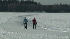 Skaters on lenghty skating-rink on frozen sea Stock Footage