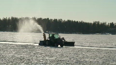 Tractor preparing skating-rink on frozen sea Stock Footage