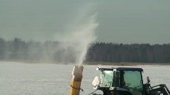 Melted ice coming from tractor chimney Stock Footage