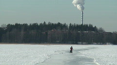 Skaters on lenghty skating-rink on frozen sea two Stock Footage