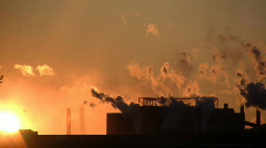 Exhaust from a factory is backlit during sunset (High Definition) Stock Footage
