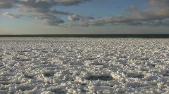Chunks of snowy ice gently bob on water (High Definition) Stock Footage