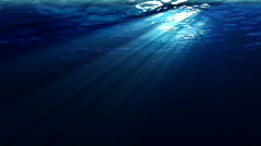 Underwater scene with sunrays shining through the water's surface. (Looping, Hig - stock footage