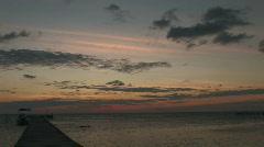 Sunrise in Caye Calker near a dock Stock Footage
