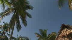 Blue sky near grass hut Stock Footage