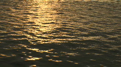 Golden water at sunset Stock Footage