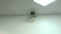 Security Camera on Wall Providing Surveillance - Big Brother - stock footage