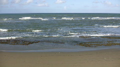Waves gently wash up onto beach, then recede (High Definition) - stock footage