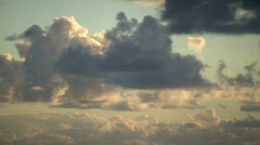 Timelapsed clouds slowly move amidst the sunrise (Hight Definition) Stock Footage