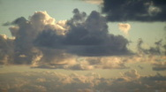 Stock Video Footage of Timelapsed clouds slowly move amidst the sunrise (Hight Definition)