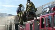 Stock Video Footage of Firemen on truck