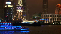 Brightly lit ship passing Shanghai, Pudong Stock Footage