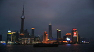 Pudong, Shanghai Skyline Across Huangpu River at Night in China Stock Footage