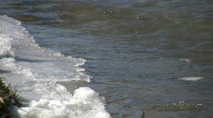 Spring season arrives, melting ice into flowing water (High Definition) Stock Footage